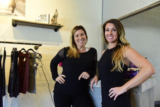 Alison Turnbaugh, left, and Carrie Aquino show off their new Evolve Studio location in Lexington.