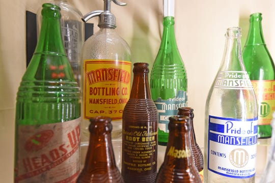 """A display of bottles from the Mansfield area are on display at the Mansfield Memorial Museum as a part of the """"Breweries and Bottlers of Mansfield, Ohio"""" exhibit."""