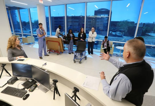 Tom Rone, right, project manager for a Turner consulting firm that is coordinating building construction and orientation, chats with medical team members on Tuesday, April 9, 2019 as they conduct a walk-through at Methodist University Hospital's new addition, Shorb Tower, to prepare for the opening of the facility later this month.