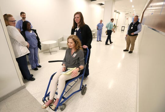 Brianna Jackson pushes Jennifer Dorman through the halls of Shorb Tower as they conduct a mock medical exercise at Methodist University Hospital's new addition on Tuesday preparing for the opening of the facility later this month.