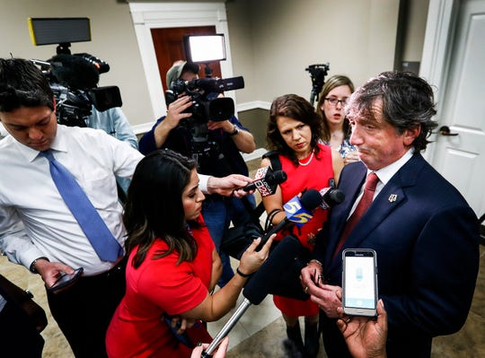 Attorney Leslie Ballin, right, speaks to the media after entering a not guilty plea April 9, 2019, for Latoshia Daniels, who is facing first-degree murder charges in the shooting death of Brodes Perry, executive pastor at Mississippi Boulevard Christian Church.
