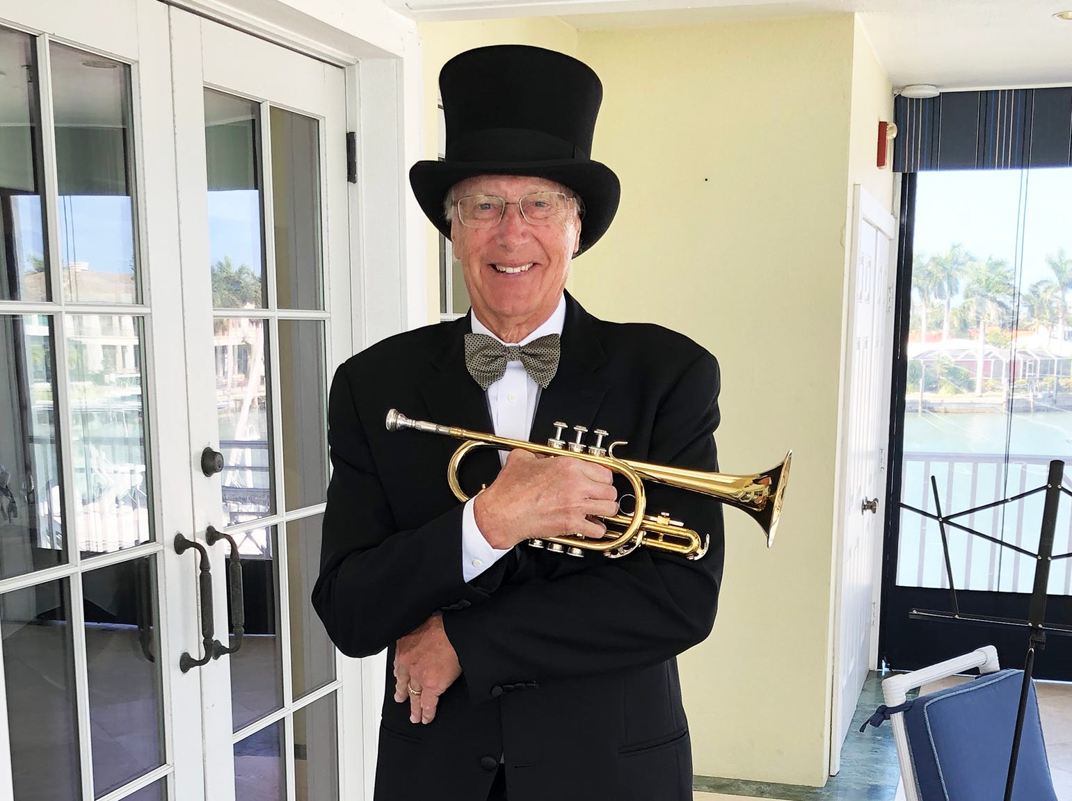 "Mike Hannafan played his cornet and wowed the crowd with his rendition of ""Puttin' on the Ritz"" and ""Moonlight Serenade."""