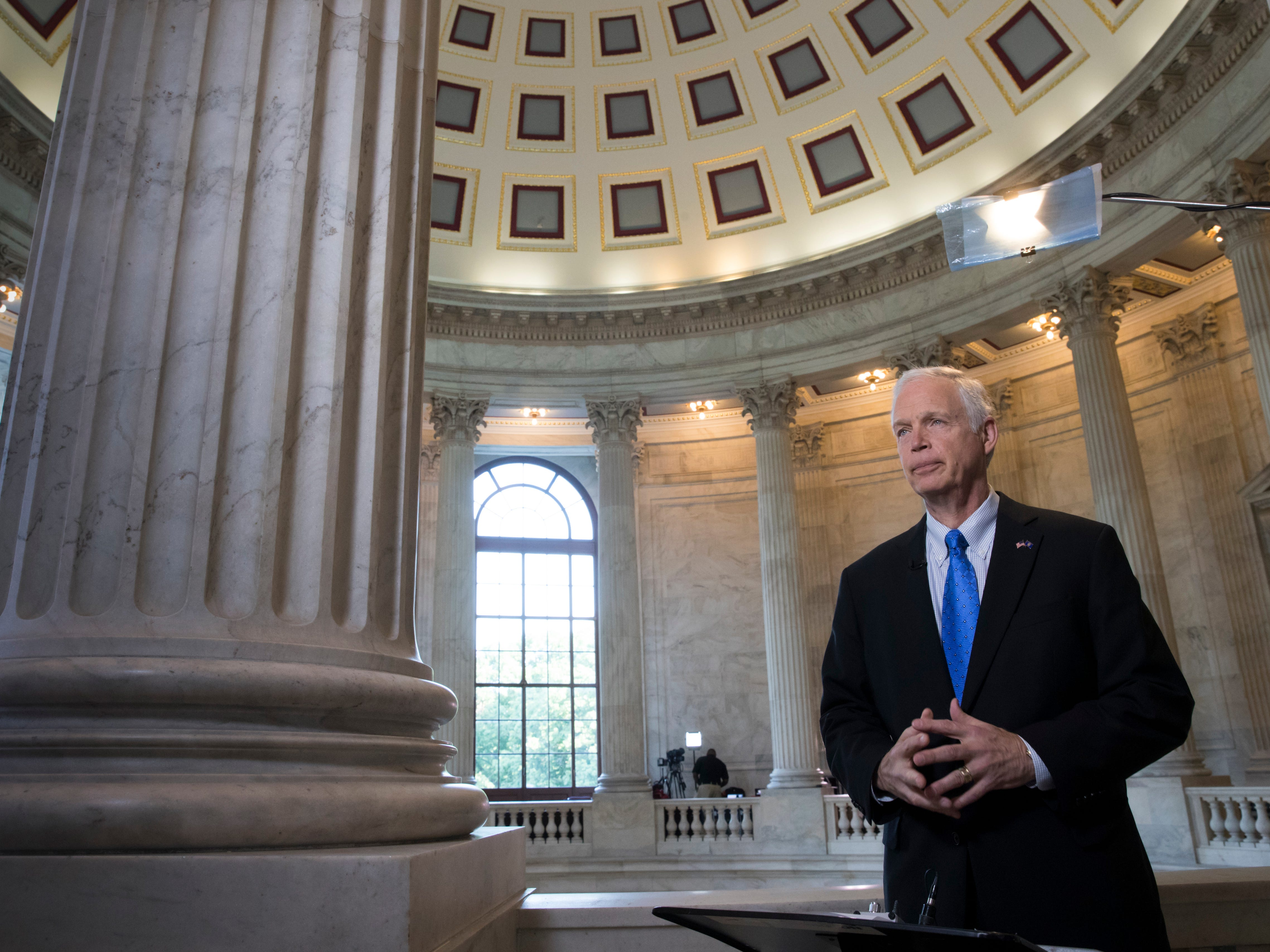 Sen. Ron Johnson, R-Wisc., waits for the start of a TV news interview on Capitol Hill as Senate Majority leader Mitch McConnell plans to release a draft of the GOP's long-awaited healthcare bill, crafted behind closed doors, which represents the party's long-awaited attempt to scuttle much of President Barack Obama's health care law.