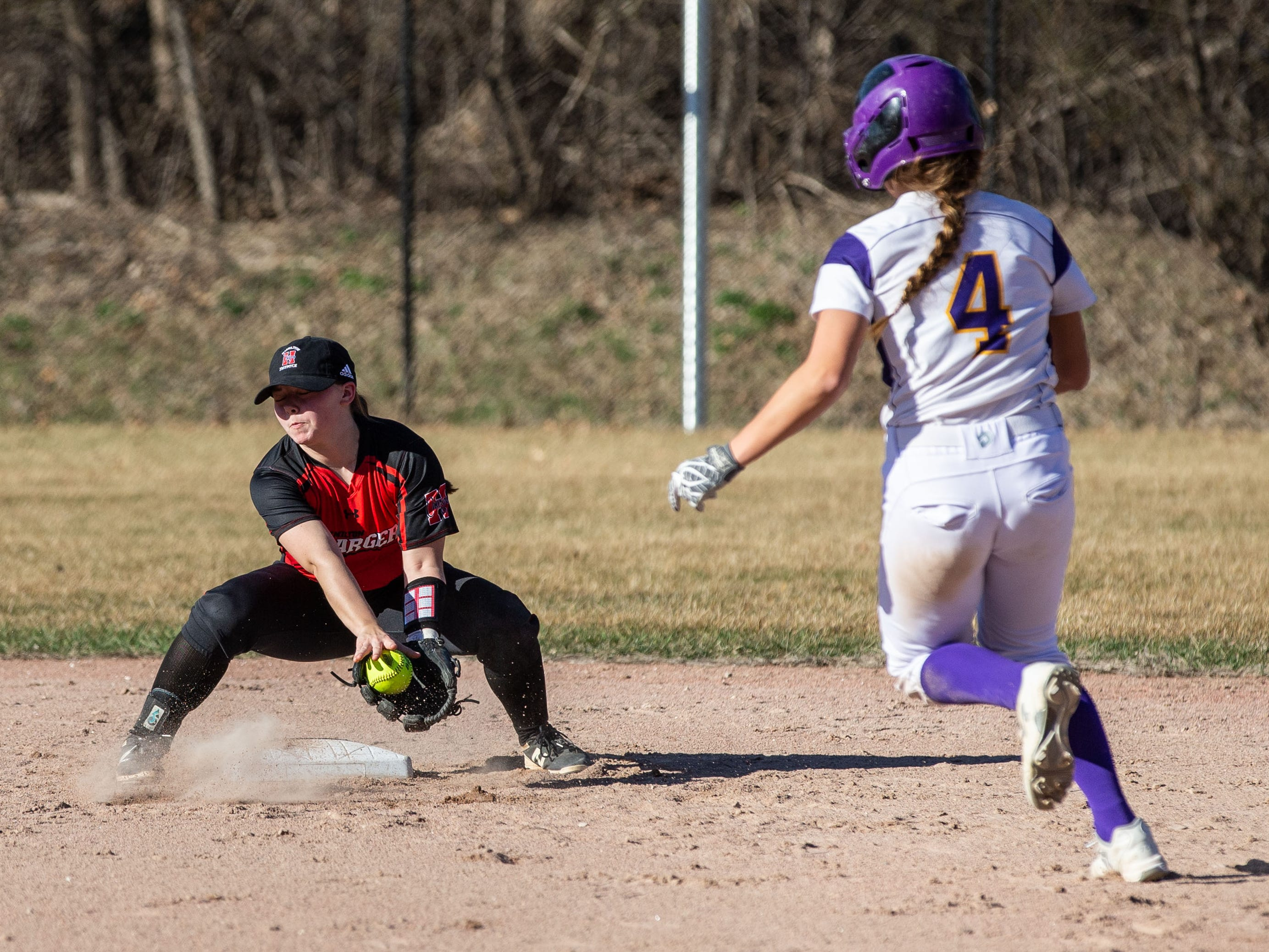 Sussex Hamilton shortstop Madison Kindler (6) gets the play at second during the game at Oconomowoc on Monday, April 8, 2019.