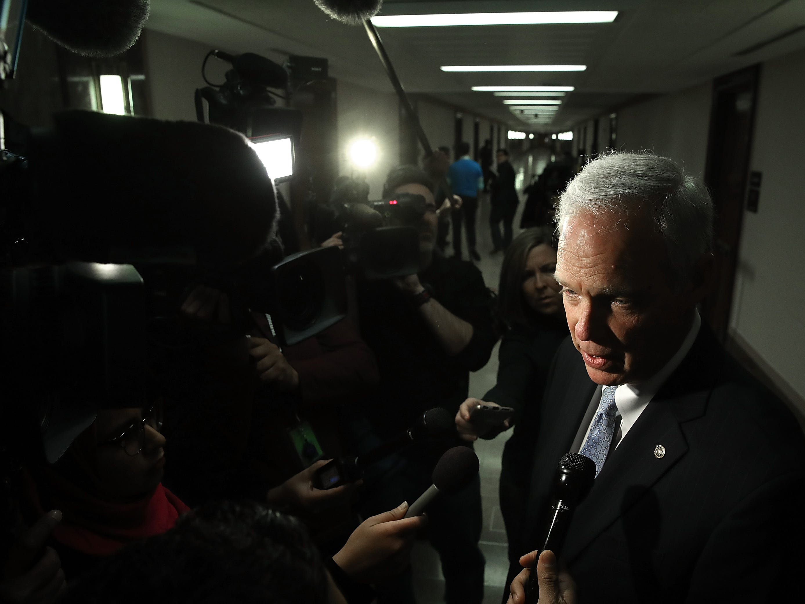 Sen. Ron Johnson (R-WI), chairman of the Homeland Security and Governmental Affairs Committee, answers questions from the press after attending a Senate Budget Committee hearing.