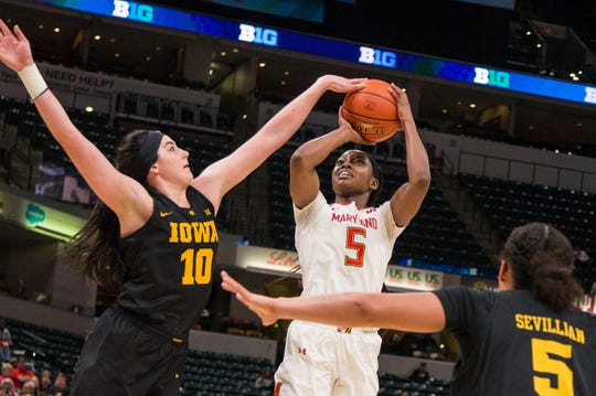 Iowa Hawkeyes forward Megan Gustafson (10) blocks the shot of Maryland Terrapins guard Kaila Charles (5) in the first half in the women's Big Ten Conference Tournament.