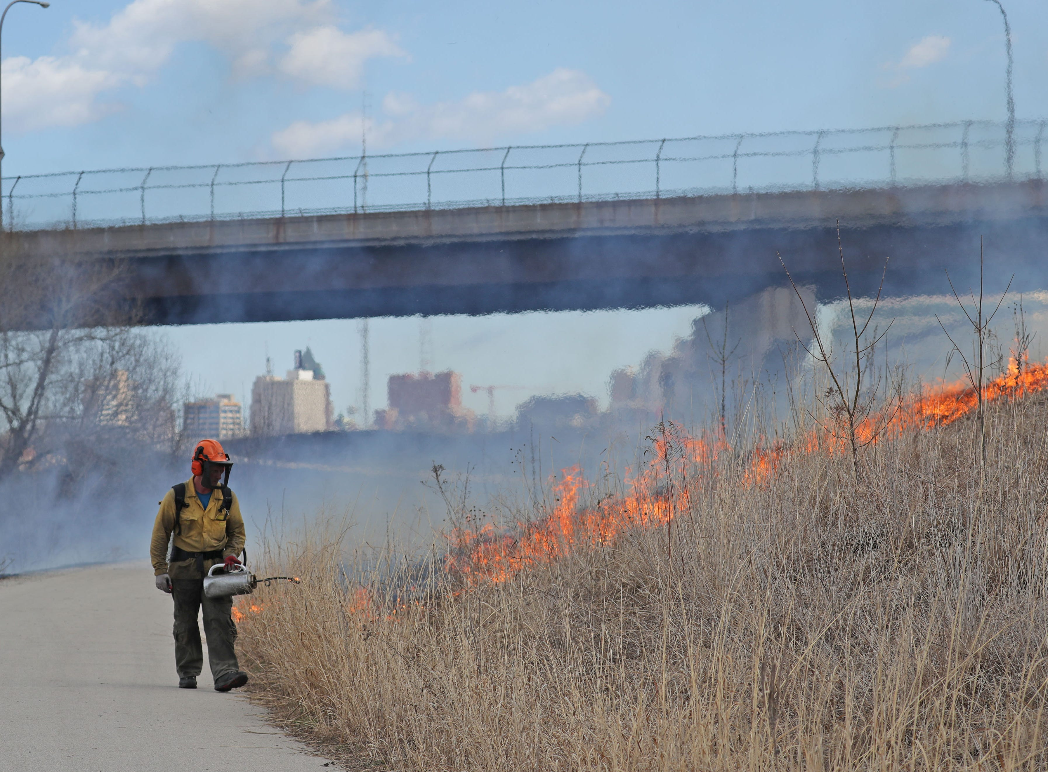 Chris Mann of  Kettle Moraine Land Stewards uses a drip torch to conduct the controlled burn.