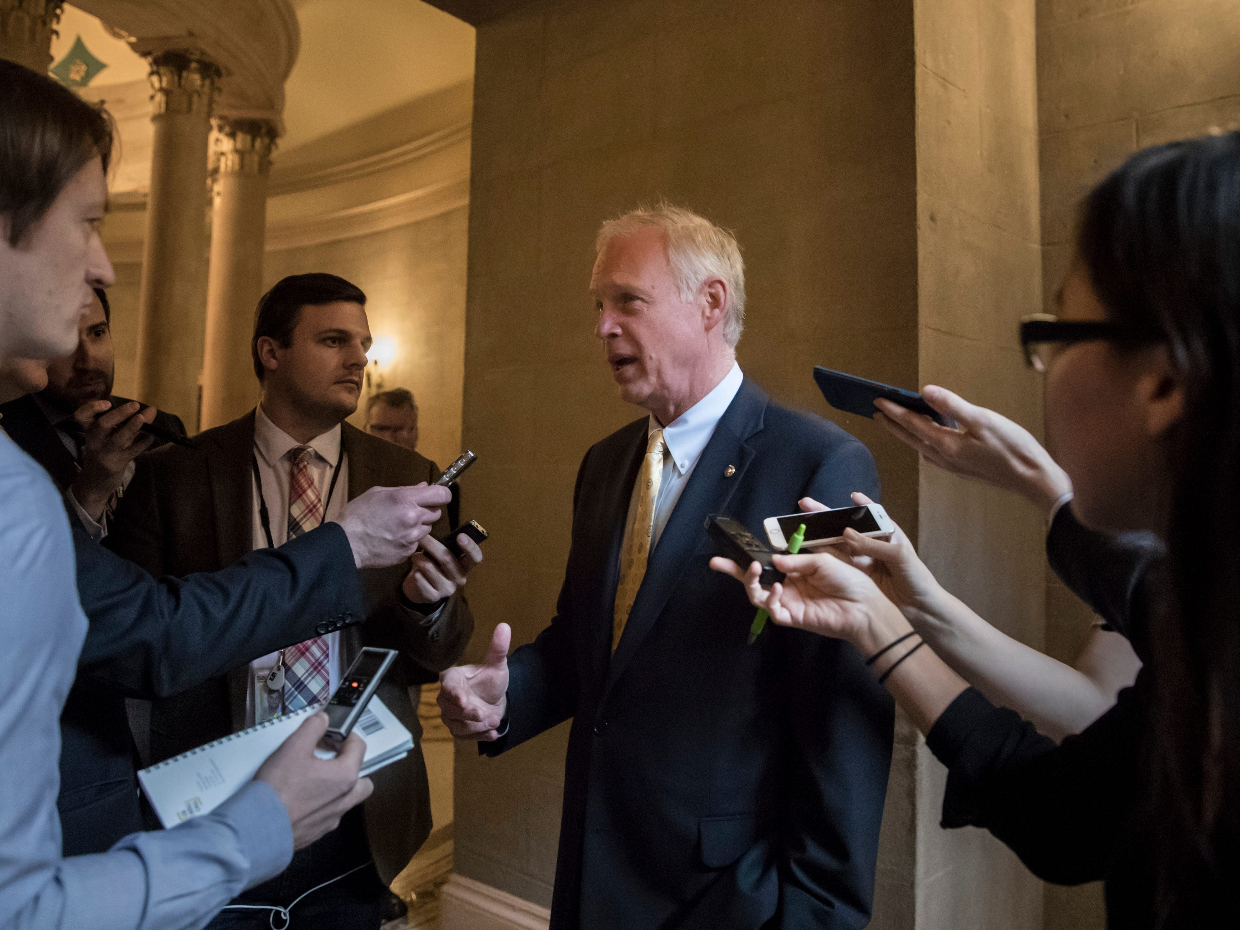 Sen. Ron Johnson, R-Wis., pauses for reporters as Republican senators gather to meet with Senate Majority Leader Mitch McConnell, R-Ky., on the stalled GOP effort to overhaul the tax code, on Capitol Hill.
