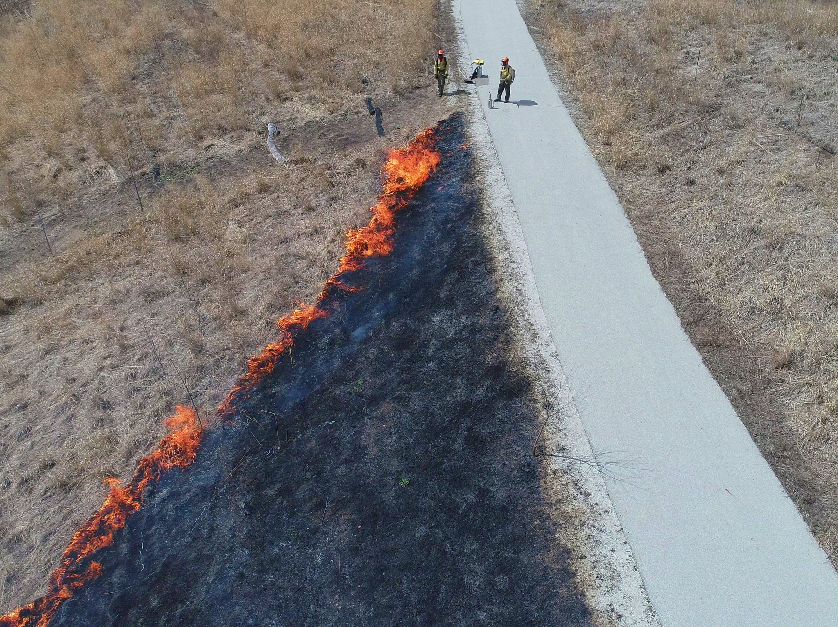 The controlled burn is monitored.