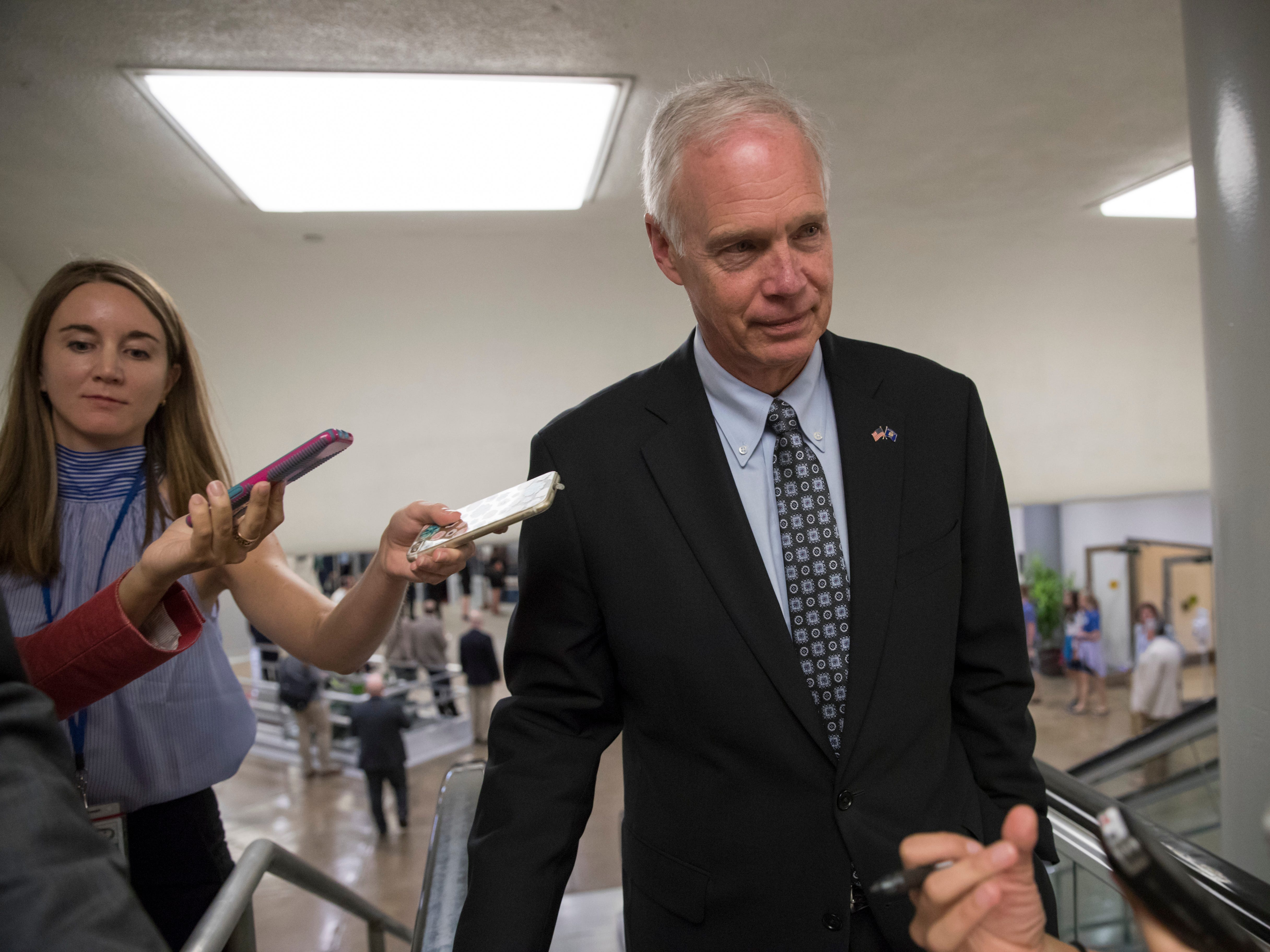 Sen. Ron Johnson, R-Wis., an opponent of the GOP health care bill, heads to the chamber for a vote, on Capitol Hill.