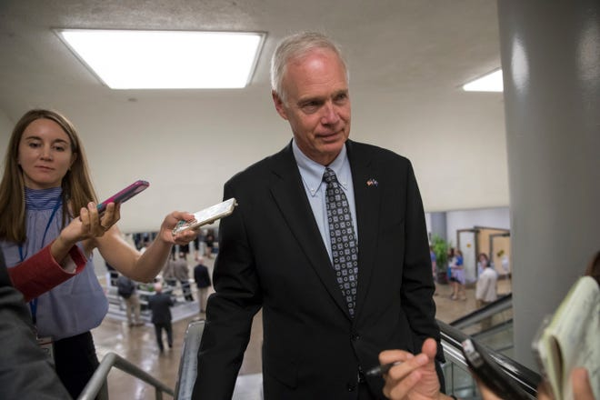 Sen. Ron Johnson, R-Wis., an opponent of the GOP health care bill, heads to the chamber for a vote on Capitol Hill.
