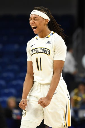 Marquette Golden Eagles guard Allazia Blockton celebrates after the second half of a semifinal game in the women's Big East Conference tournament.