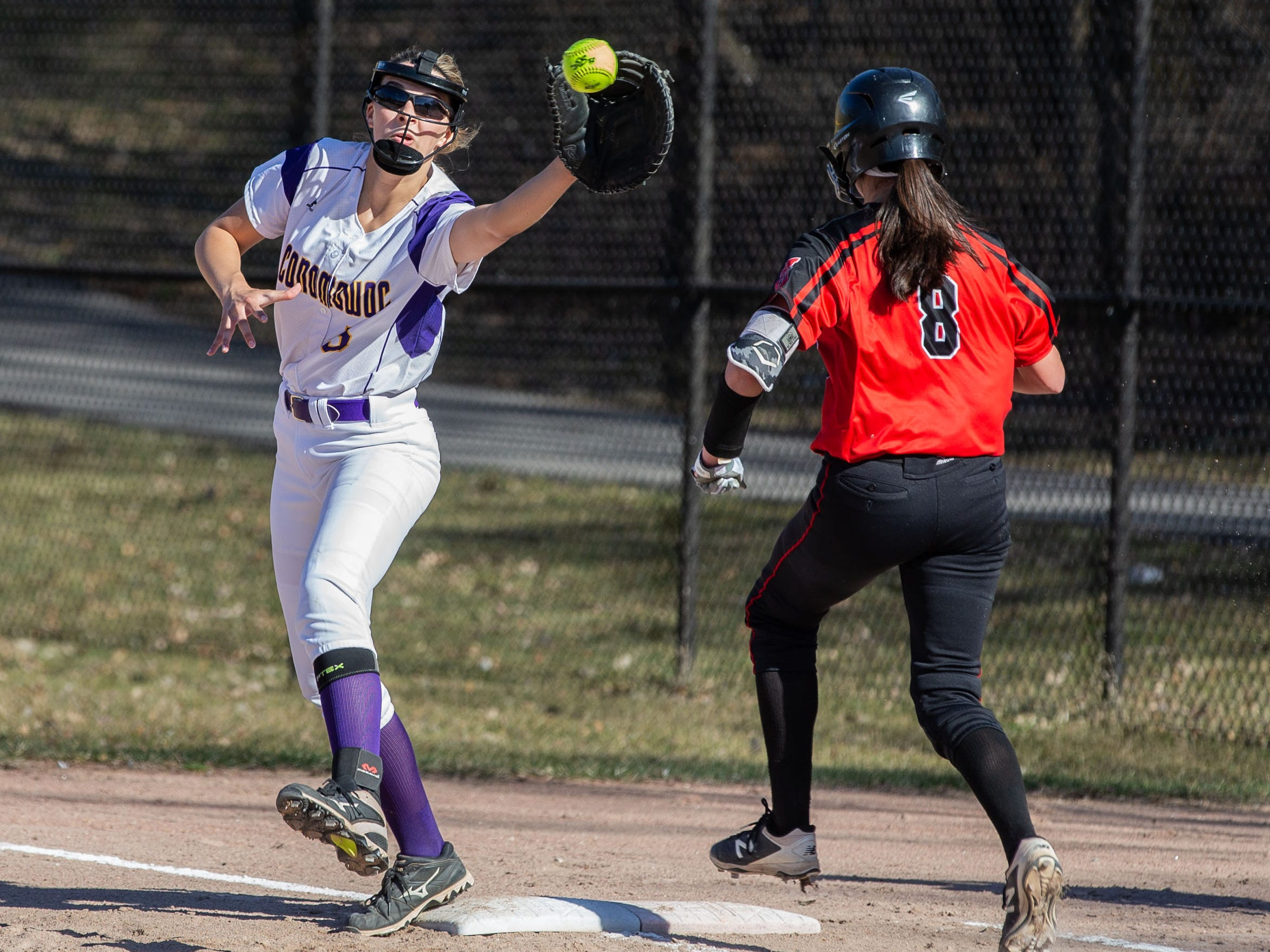 Oconomowoc's Taylor Eckert (5) gets the play at first during the game at home against Sussex Hamilton on Monday, April 8, 2019.