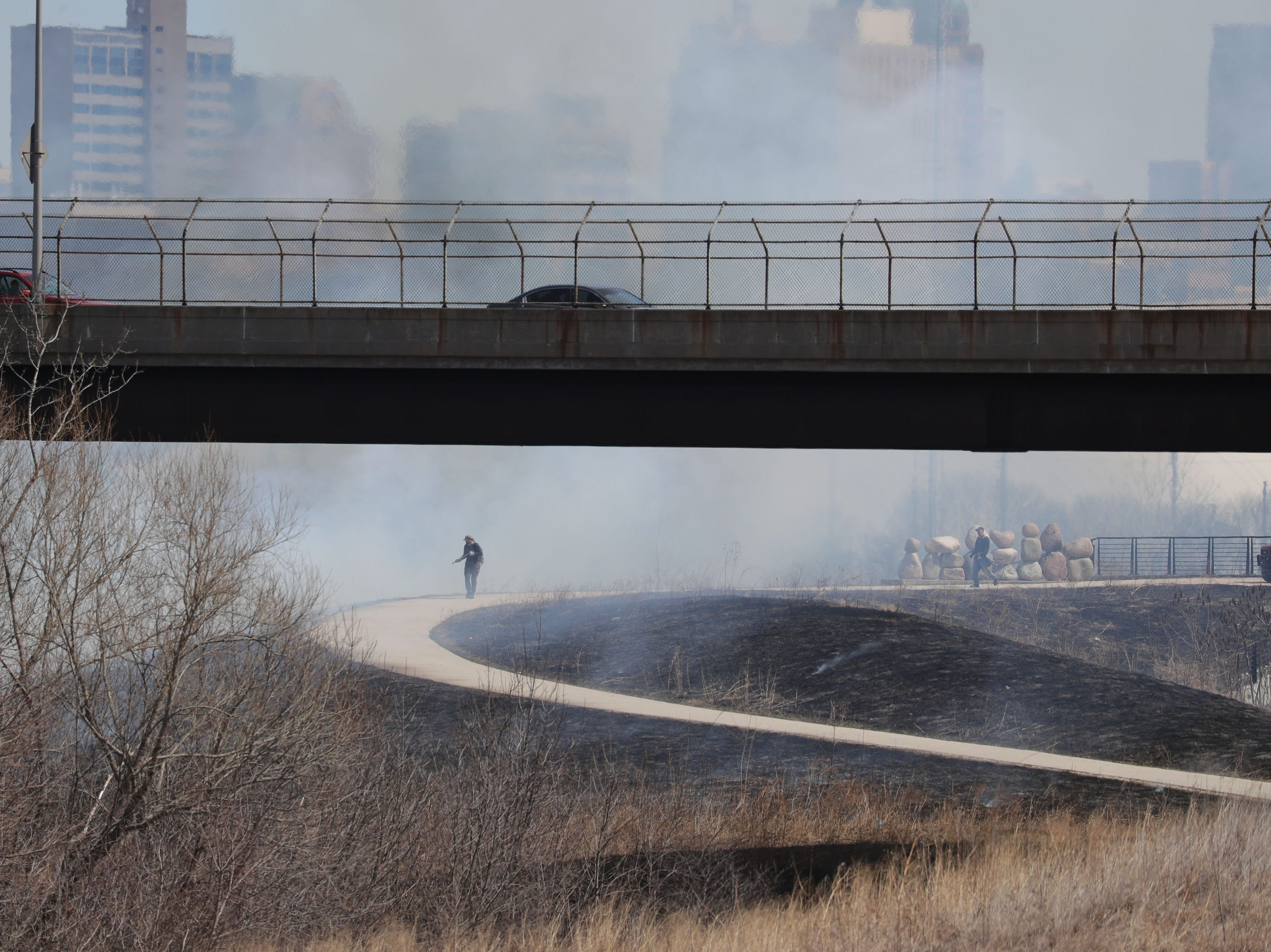 Smoke rises from the controlled burn.