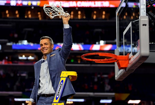 Virginia head coach Tony Bennett cuts down the net after winning the 2019 NCAA basketball national championship Monday night.