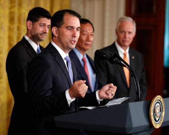 Wisconsin Gov. Scott Walker speaks in the East Room accompanied by House Speaker Paul Ryan of Wis., Foxconn CEO and founder Terry Gou, and Sen. Ron Johnson, R-Wis., at the White House in Washington.