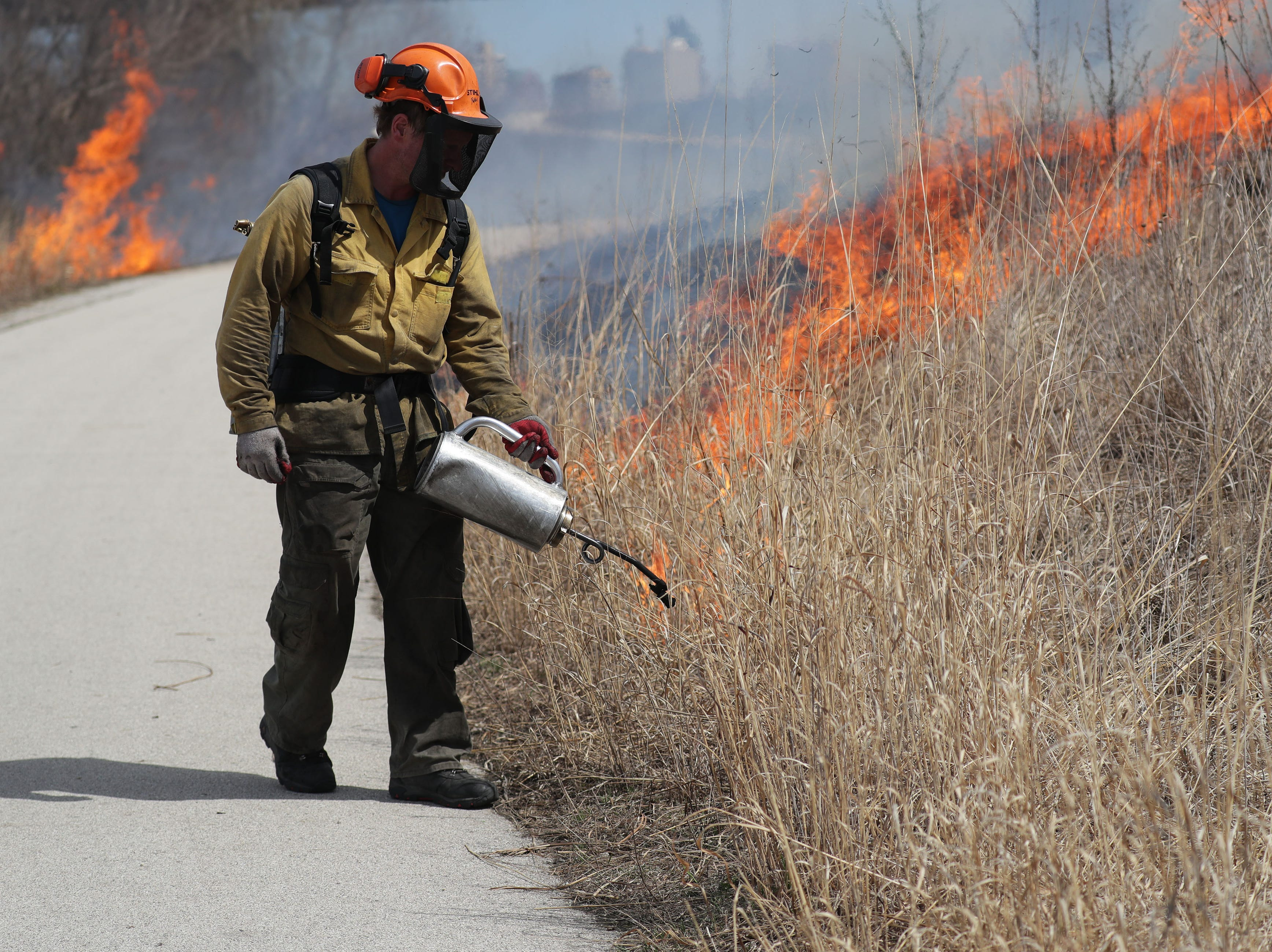 Chris Mann with Kettle Moraine Land Stewards uses a drip torch to conduct the controlled burn.