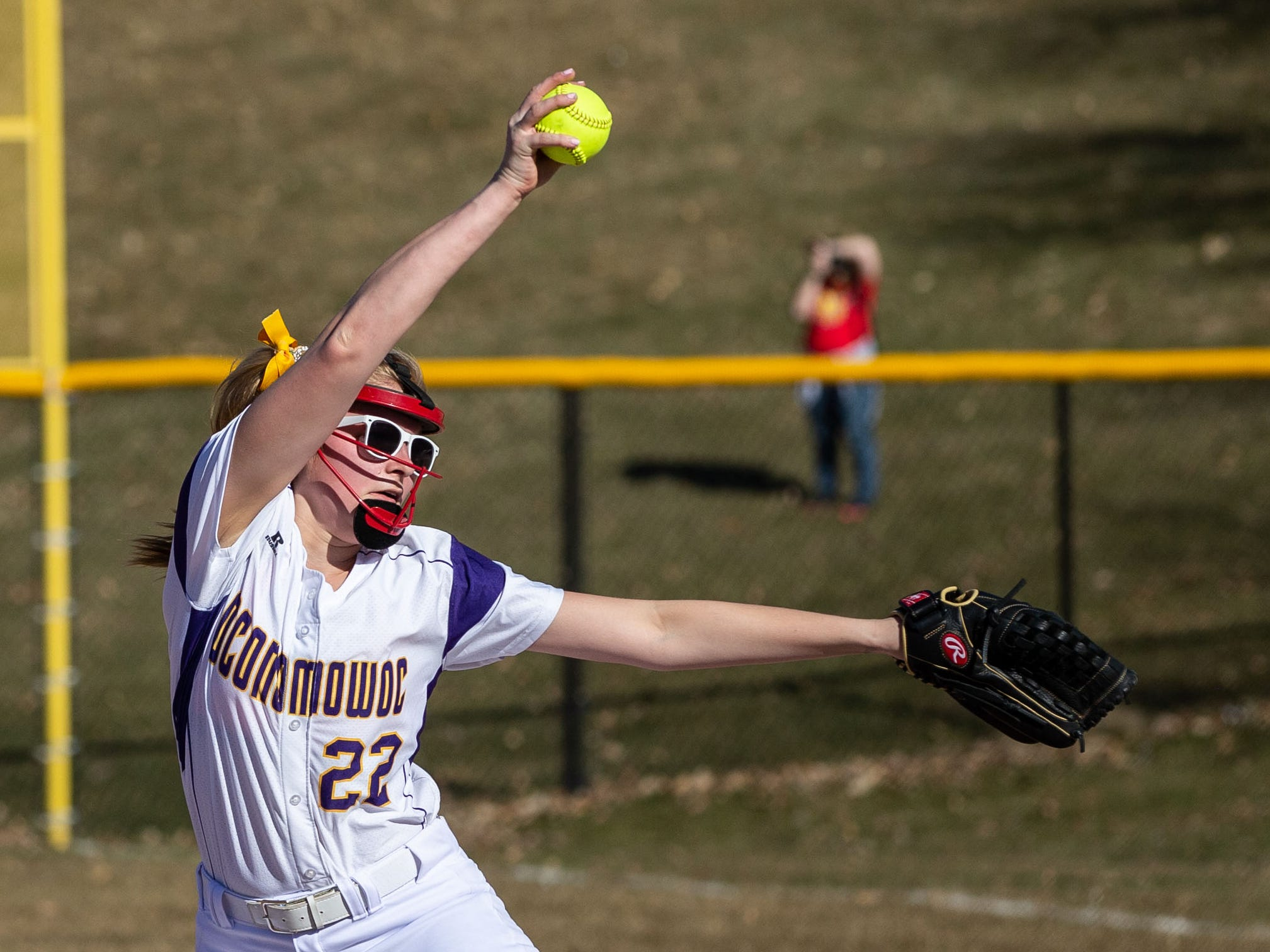 Oconomowoc pitcher Sarah Kopfer (22) winds up during the game at home against Sussex Hamilton on Monday, April 8, 2019.