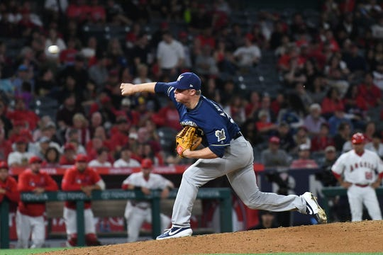 Brewers pitcher Chase Anderson gave up a home run in the eighth inning to Justin Bour.