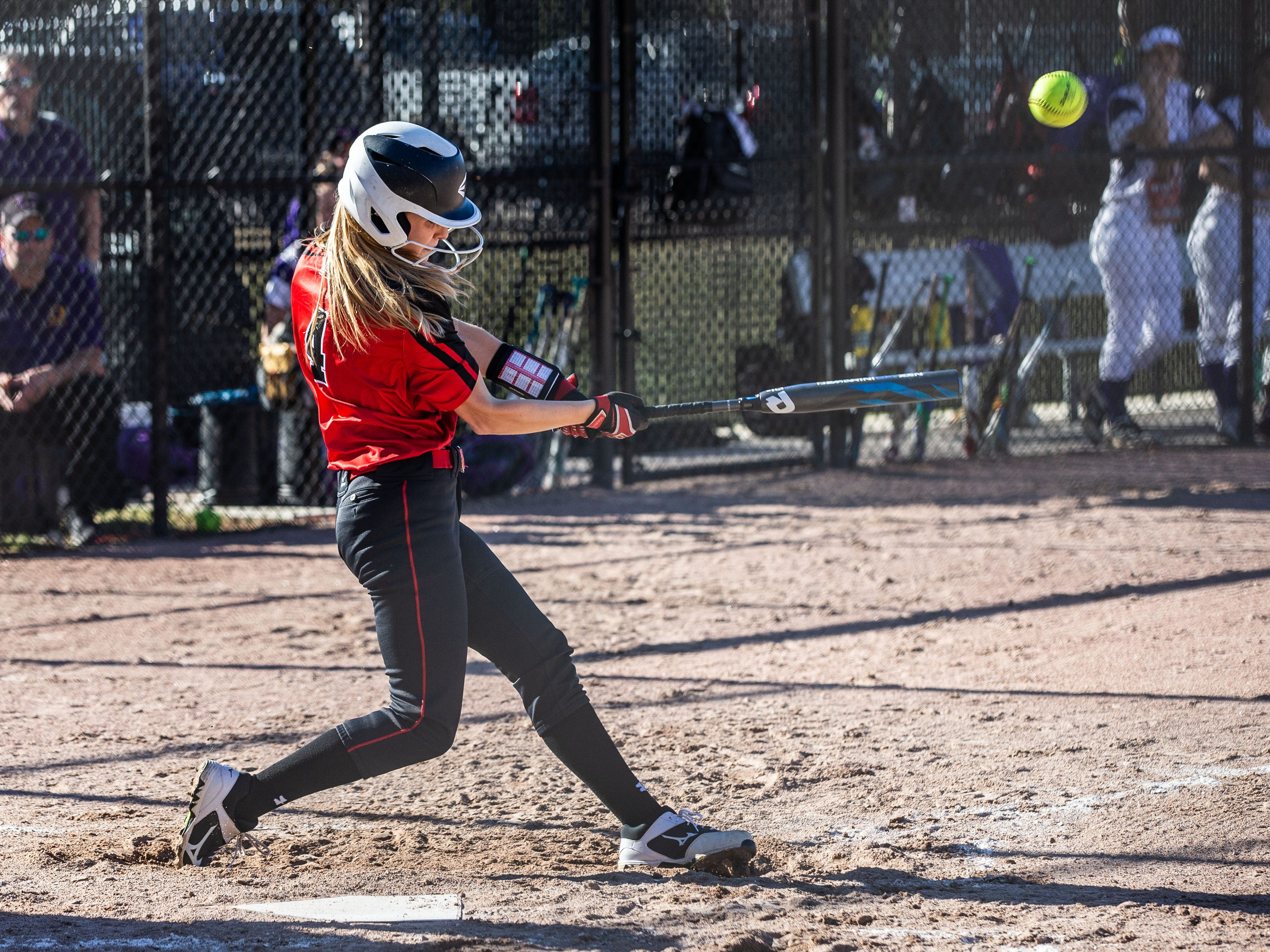 Sussex Hamilton's Ellie Prell (4) connects during the game at Oconomowoc on Monday, April 8, 2019.