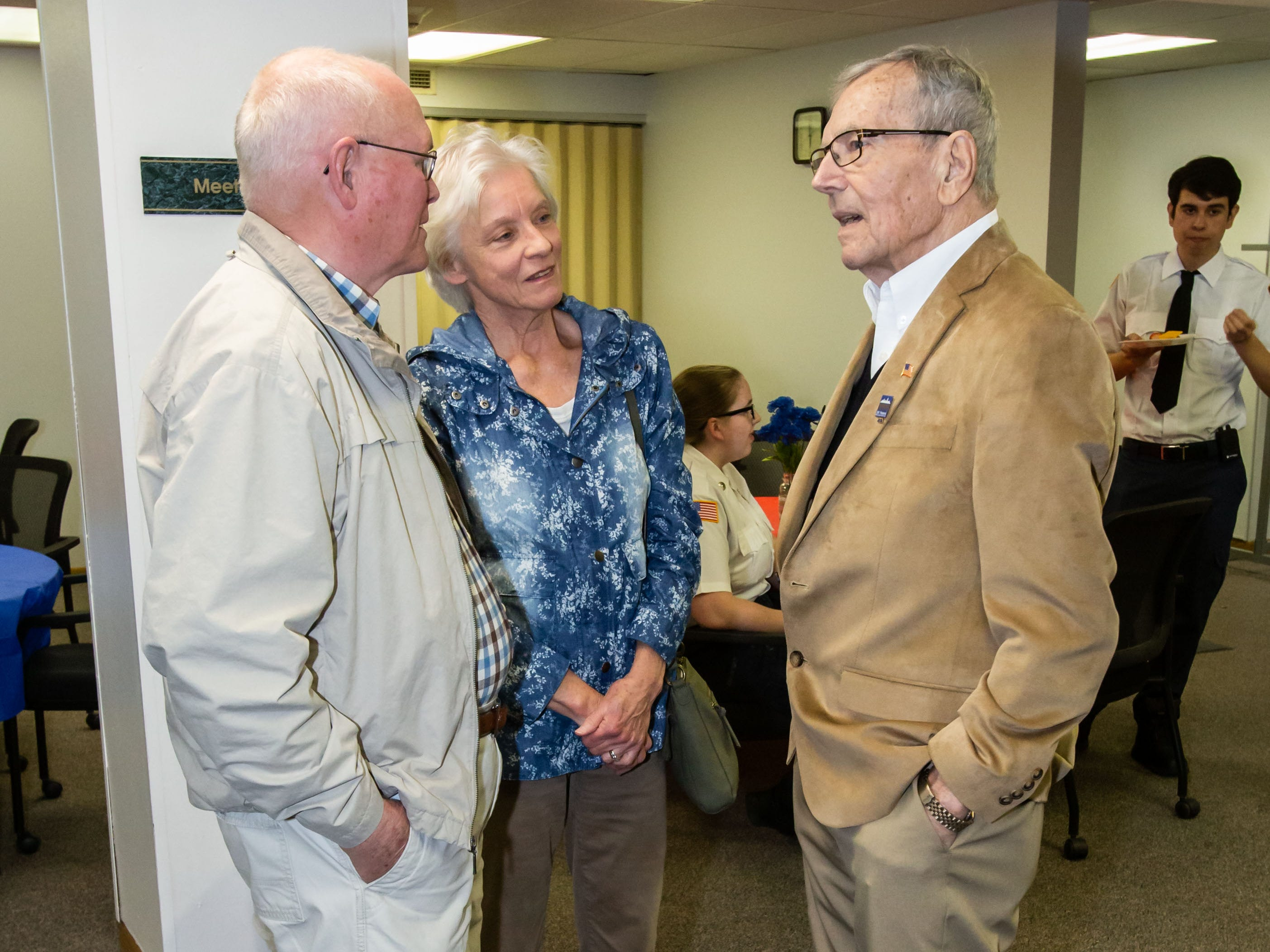 Jim and Cathy Wilson of Delafield chat with Hartland Village Board trustee Richard Landwehr (right) during a reception in his honor on Monday, April 8, 2019. Richard is retiring from the board after 53 years of service.