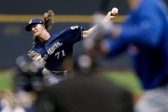 Josh Hader pitches to Anthony Rizzo of the Chicago Cubs in the seventh inning at Miller Park on April 07, 2019 in Milwaukee.