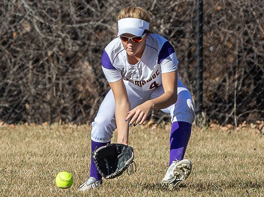 Oconomowoc outfielder Molly Schlosser (4) scoops one up during the game at home against Sussex Hamilton on Monday, April 8, 2019.