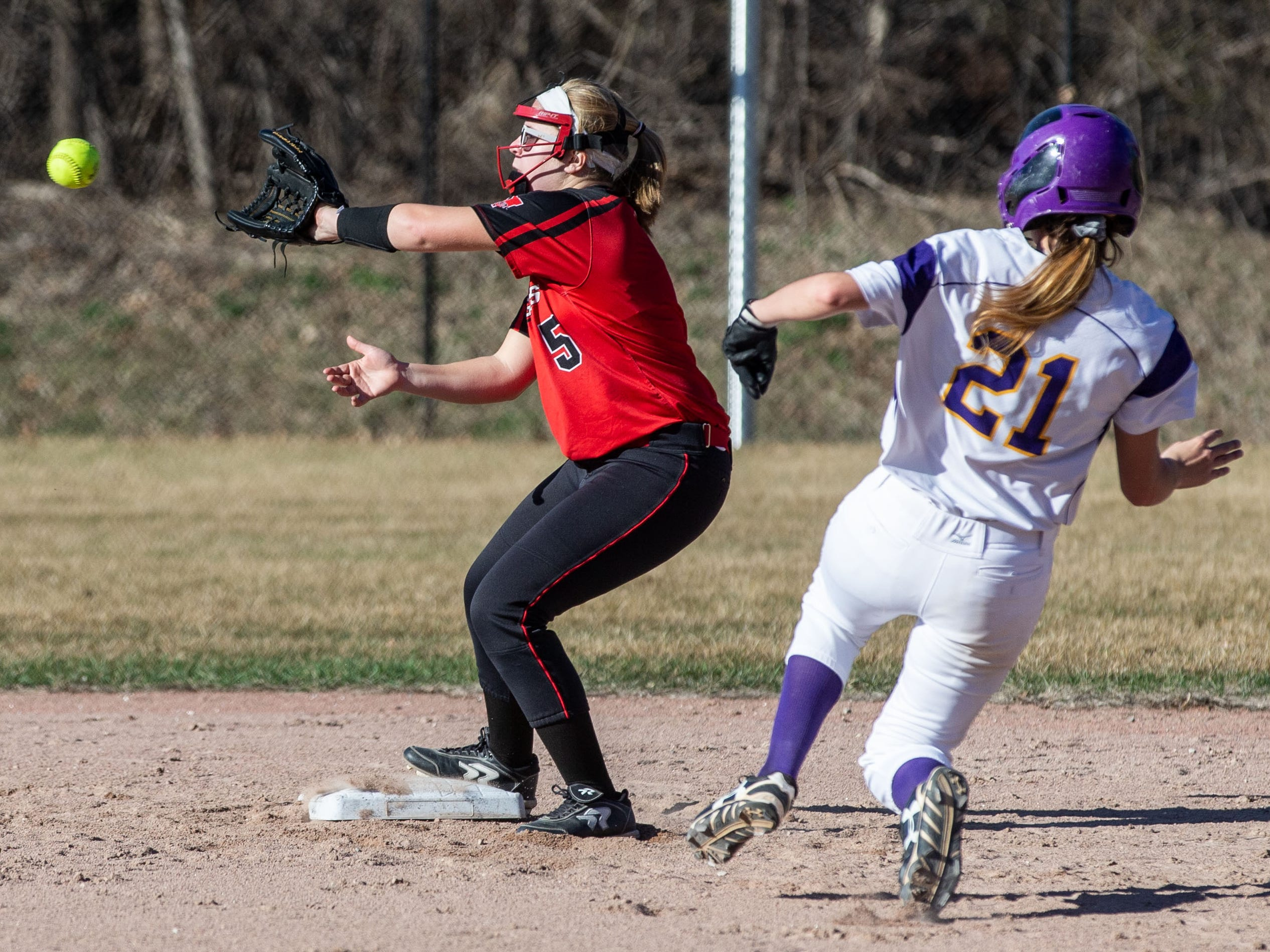 Sussex Hamilton's Maddie Claas (5) gets the force at second during the game at Oconomowoc on Monday, April 8, 2019.