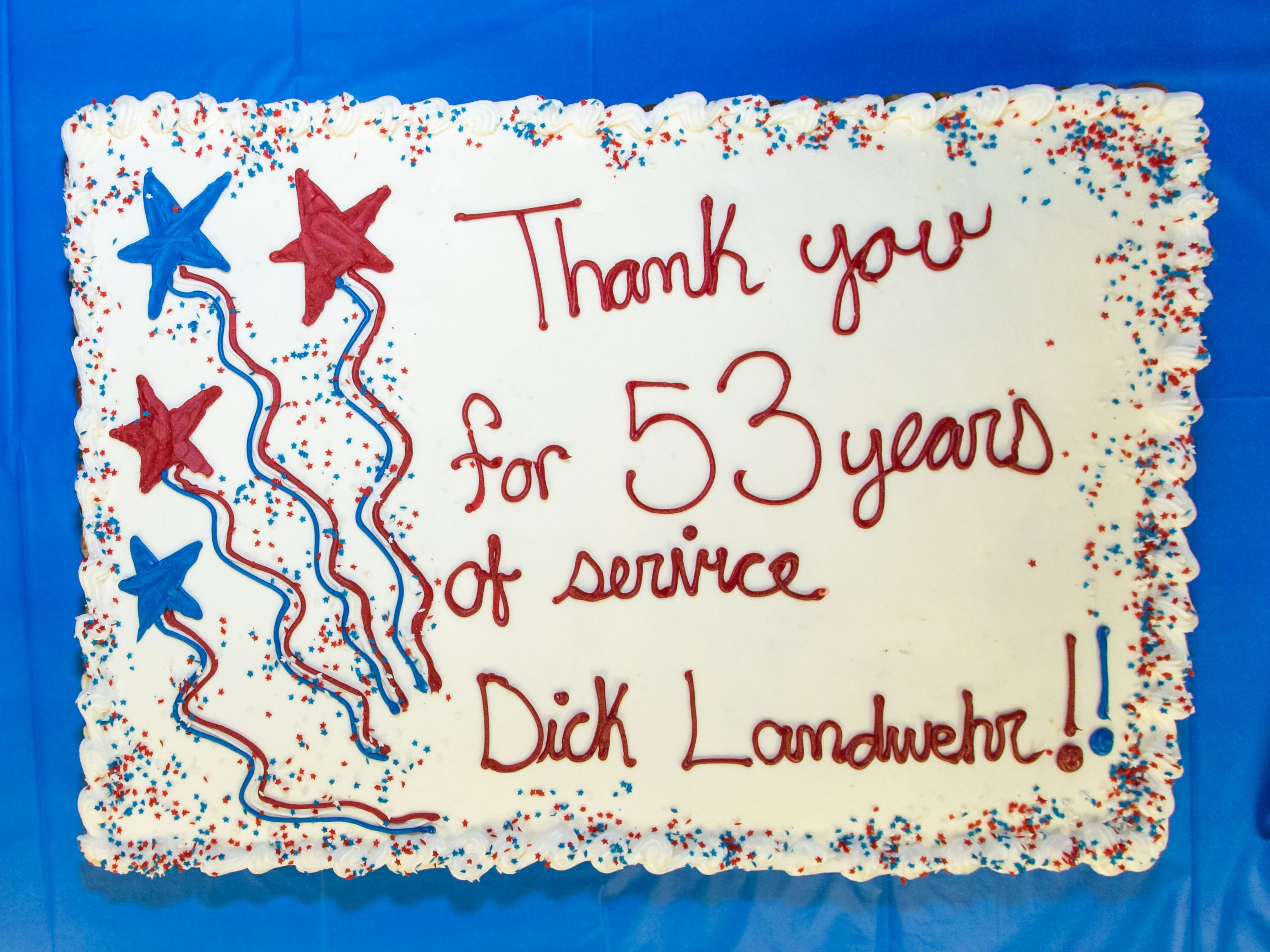 A cake is decorated to celebrate Hartland Village Board trustee Richard Landwehr's 53 years of service during his retirement reception on Monday, April 8, 2019.