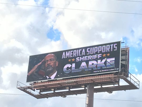 "An image of David A. Clarke Jr. appeared on an electronic billboard this week on I-94/ I-43 near the Kinnickinnic River with the message, ""America supports Sheriff Clarke."""