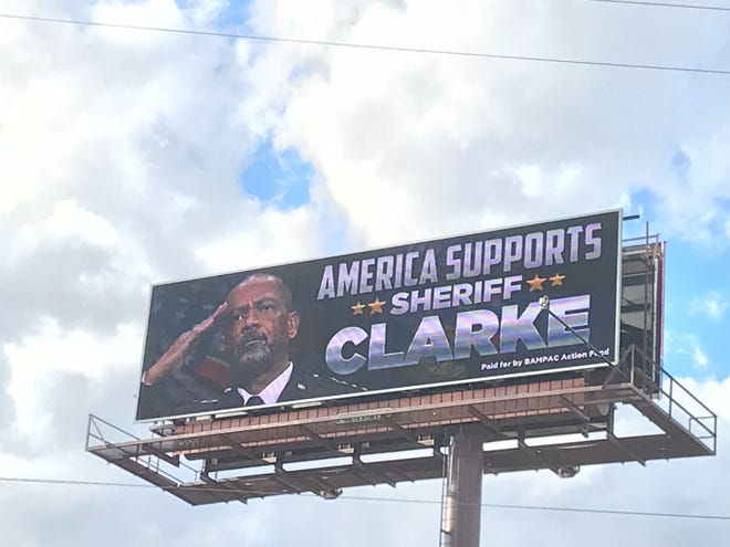 """An image of David A. Clarke Jr. appeared on an electronic billboard this week on I-94/ I-43 near the Kinnickinnic River with the message, """"America supports Sheriff Clarke."""""""