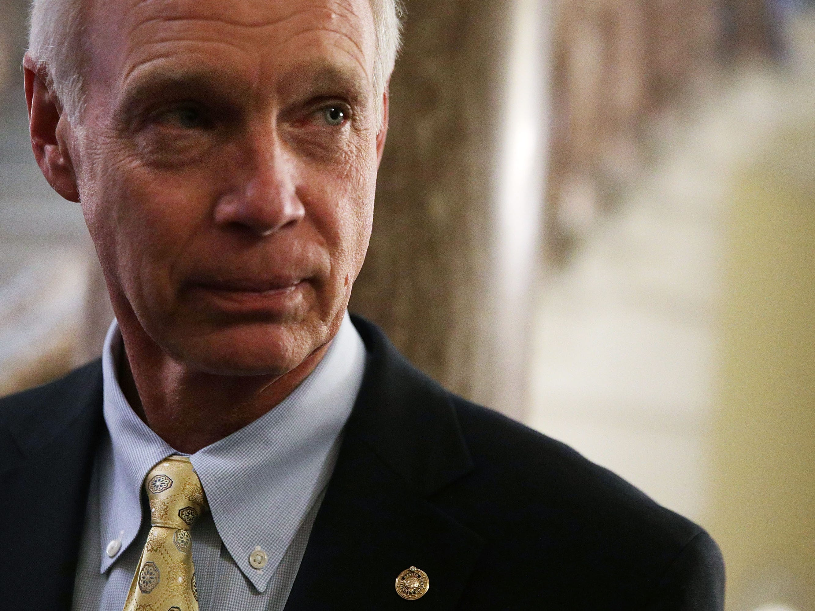 Sen. Ron Johnson (R-WI) listens to a question from a member of the press at the Capitol.