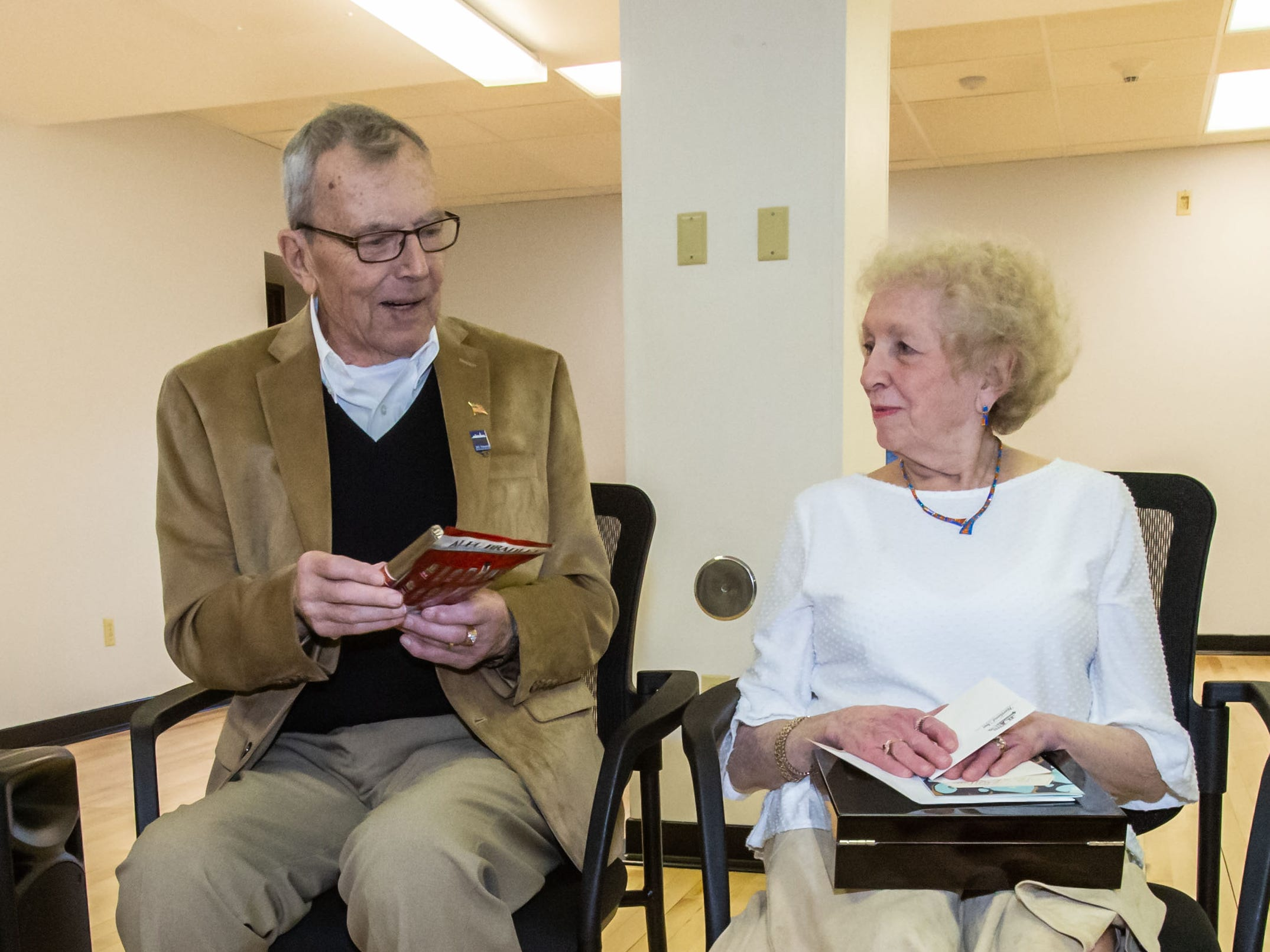 Hartland Village Board trustee Richard Landwehr and his wife Janet open gifts during reception in Richard's honor on Monday, April 8, 2019. Richard is retiring from the board after 53 years of service.