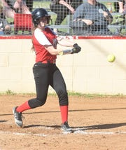 Norfork's Kylie Manes connects with a pitch during the Lady Panthers' 27-12 win over Izard County on Monday.