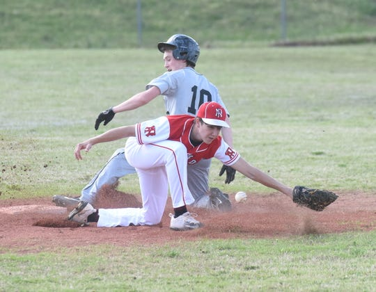 Izard County's Noah Everett slides into second base safely as the throw goes by Norfork shortstop Tyler Sorters on Monday at Norfork.