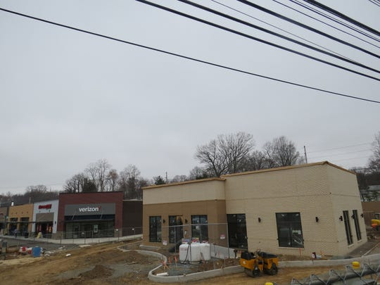 At right, construction continues on the standalone Chick-fil-A restaurant at Briarcliff Commons in Morris Plains. The company has pushed back the grand opening of its first Morris County location to summer. April 9, 2019
