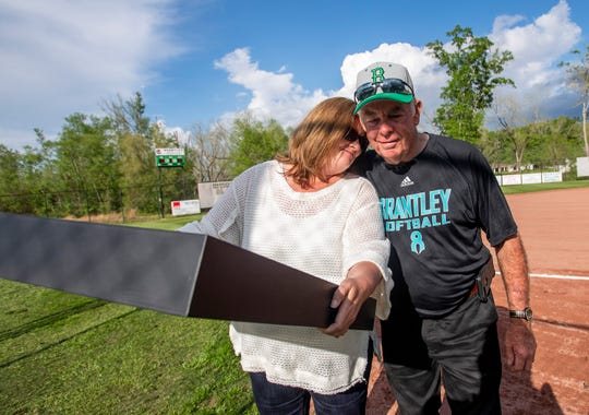 LeAnn Wilcox gets a hug follwing a ceremony where the Brantley High School softball field is named for her daughter and former player Alex Wilcox and her jersey is retired  in Brantley, Ala., on Tuesday April 9, 2019.
