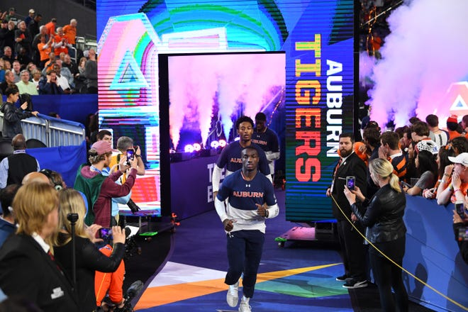 Auburn guard Jared Harper leads the team onto the floor against Virginia in the Final Four at US Bank Stadium on April 6, 2019, in Minneapolis.