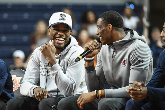 Auburn seniors Malik Dunbar (left) and Horace Spencer (right) smile after the team returns to Auburn Arena on Sunday, April 7, 2019.
