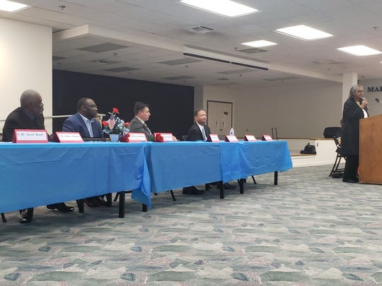 Bibby Simmons, Marcus McNeal, Michael Fritz and Artur Davis, from left to right, sit at a forum for mayoral candidates