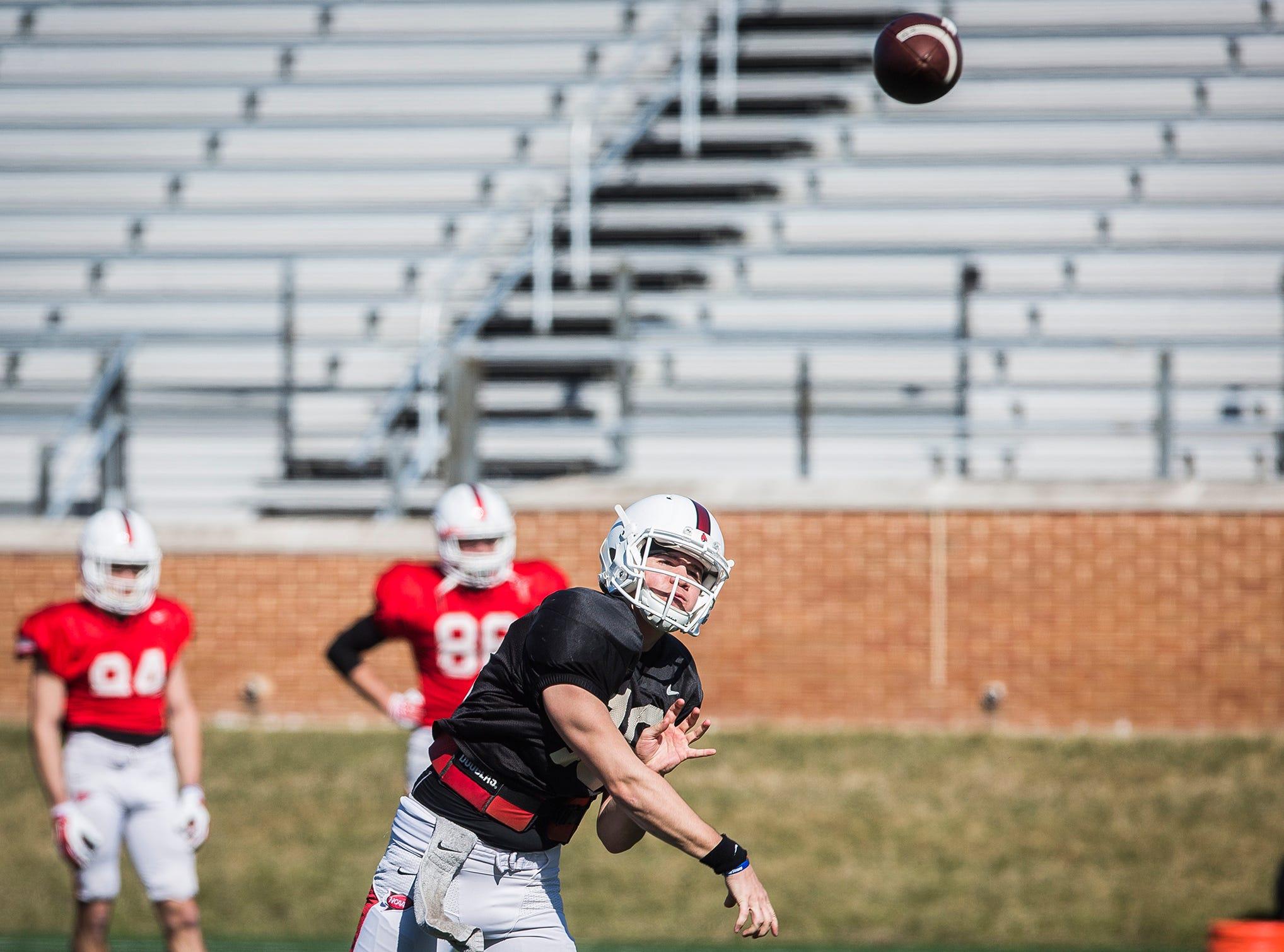 Ball State quarterback John Paddock practices with teammates at Scheumann Stadium.