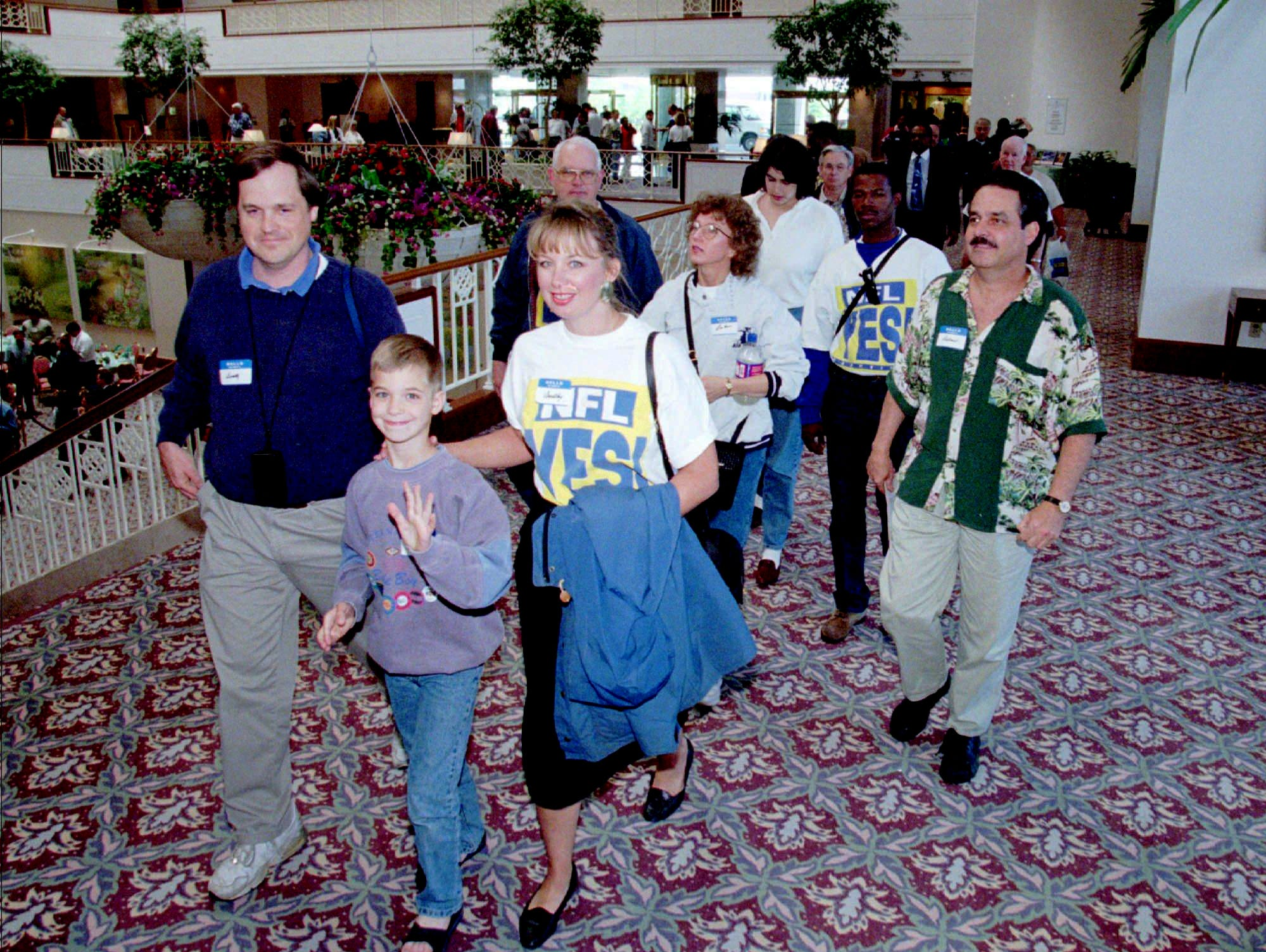 Tennesseans supporting the relocation of the Houston Oilers to Nashville arrive at an Atlanta hotel April 30, 1996 where NFL owners were meeting to vote on the move. The owners approved the move in a four and a half hour meeting.