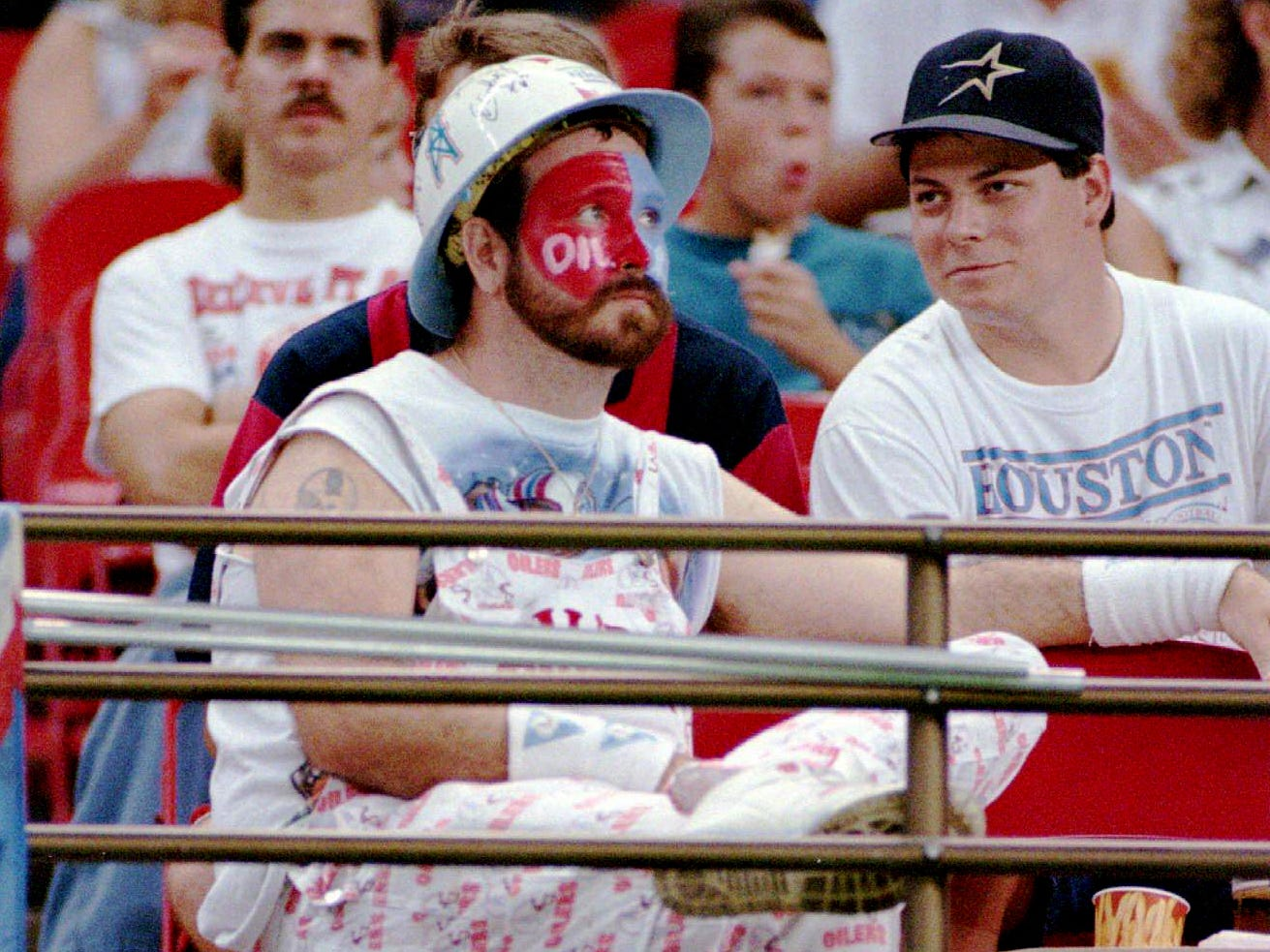 Houston Oilers fan Chris Lockridge, 30, makes public his feelings about the possibility of a team move to Nashville with a sign in the Astrodome before a scheduled game against the San Diego Chargers Aug. 19, 1995 in Houston. Lockridge is a 10-year season ticket holder. The game was cancelled 72 minutes after the scheduled start time because of conditions of the playing field.