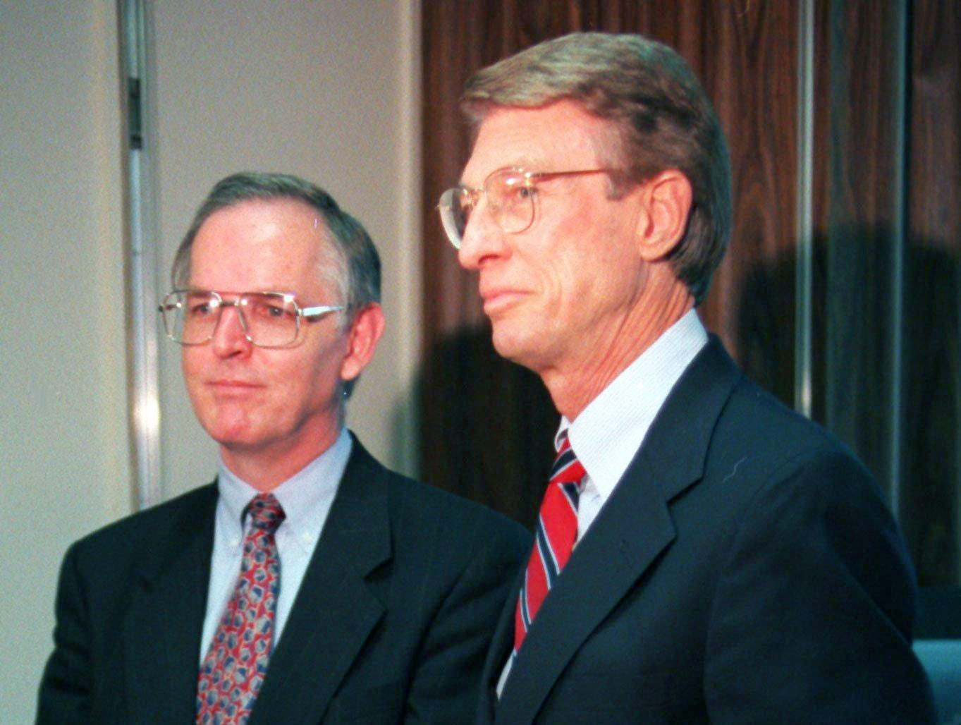 Mike McClure, left, of the Houston Oilers and David Stringfield of Baptist Hospital, announce to the press the location of the the proposed Oilers' new practice faclites at the Baptist Bellevue location April 14, 1997. Stringfield is holding a brochure Baptist used in its presentation to the Oilers.