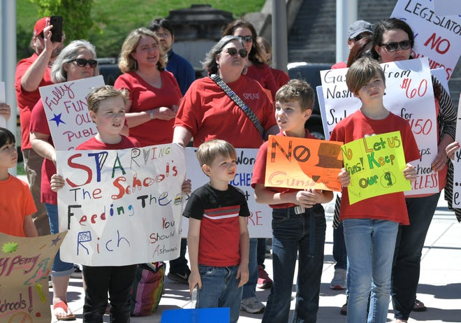 People from Tennessee Strong protest Gov. Lee's voucher proposal at Speaker Beth Harwell Plaza in Nashville, Tenn, on Tuesday. April 9, 2019.