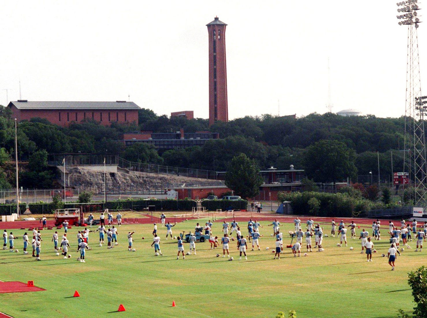 Houston Oilers players warming up before start of the practice on the field of Trinity University, home of their training camp in San Antonio, Texas July 26, 1996.