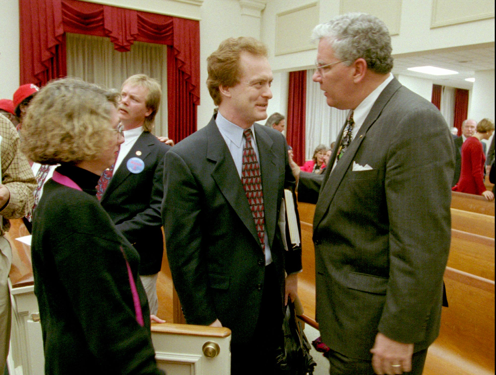 Attorney Byron Trauger, center, is congratulated by councilman George Armistead, right, in the Nashville Metro council chamber on Nov. 21, 1995, after the council voted 28-9 to approve a legal agreement between the mayor and Houston Oilers owner Bud Adams to move the NFL team to Nashville. The vote extends to March the exclusive negotiating agreement between the city and the Oilers, which would have expired Nov. 25. Trauger heads Nashville's negotiating team.