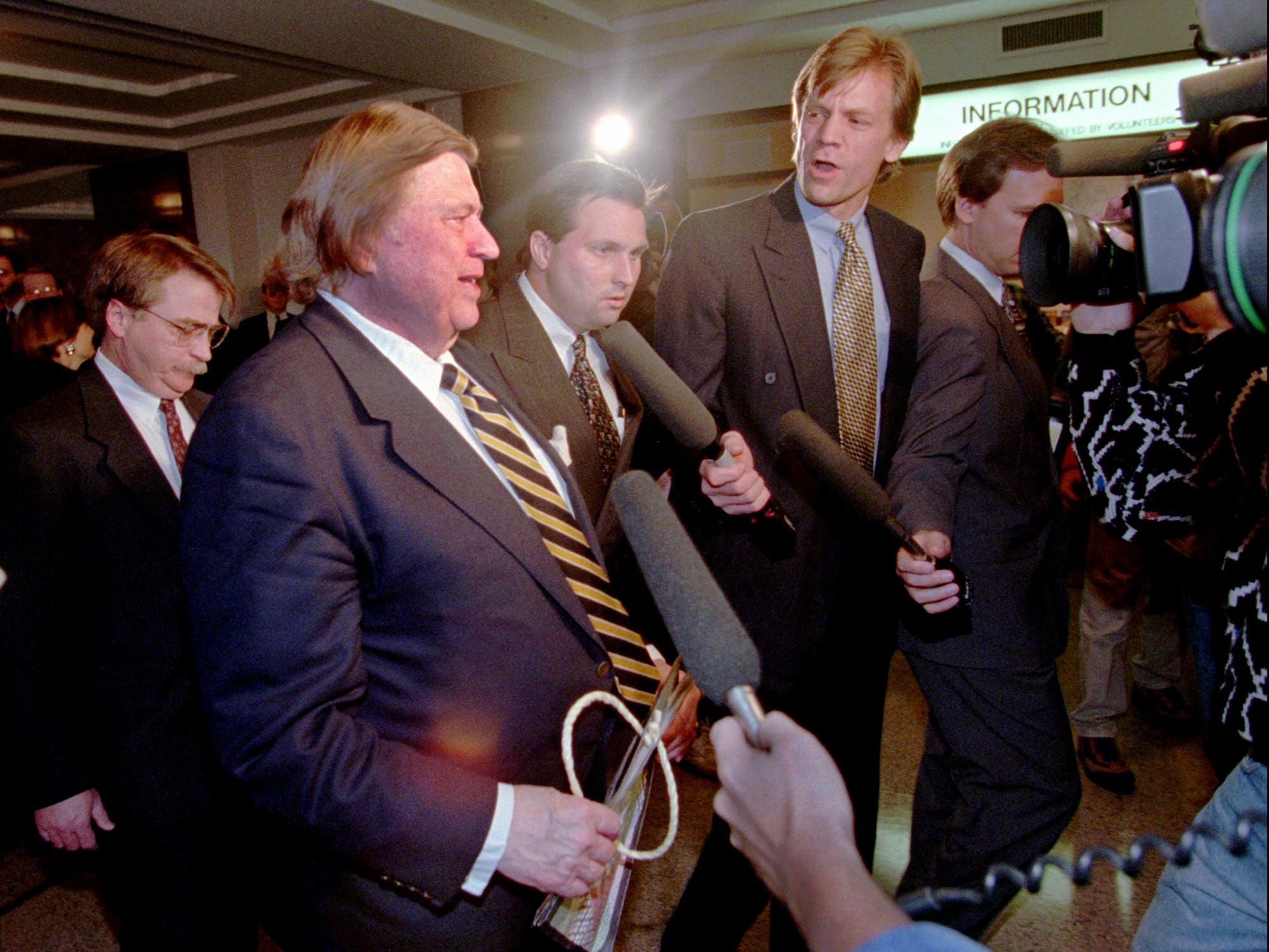Houston Oilers owner Bud Adams, second from left, is the center of attention in Nashville Nov. 16, 1995 after he signed the deal that will move the Oilers to Nashville providing the city fulfills its requirements.