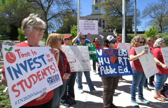 People from Tennessee Strong protest Gov. Lee's voucher proposal at Speaker Beth Harwell Plaza in Nashville, Tenn, on Tuesday, April 9, 2019.