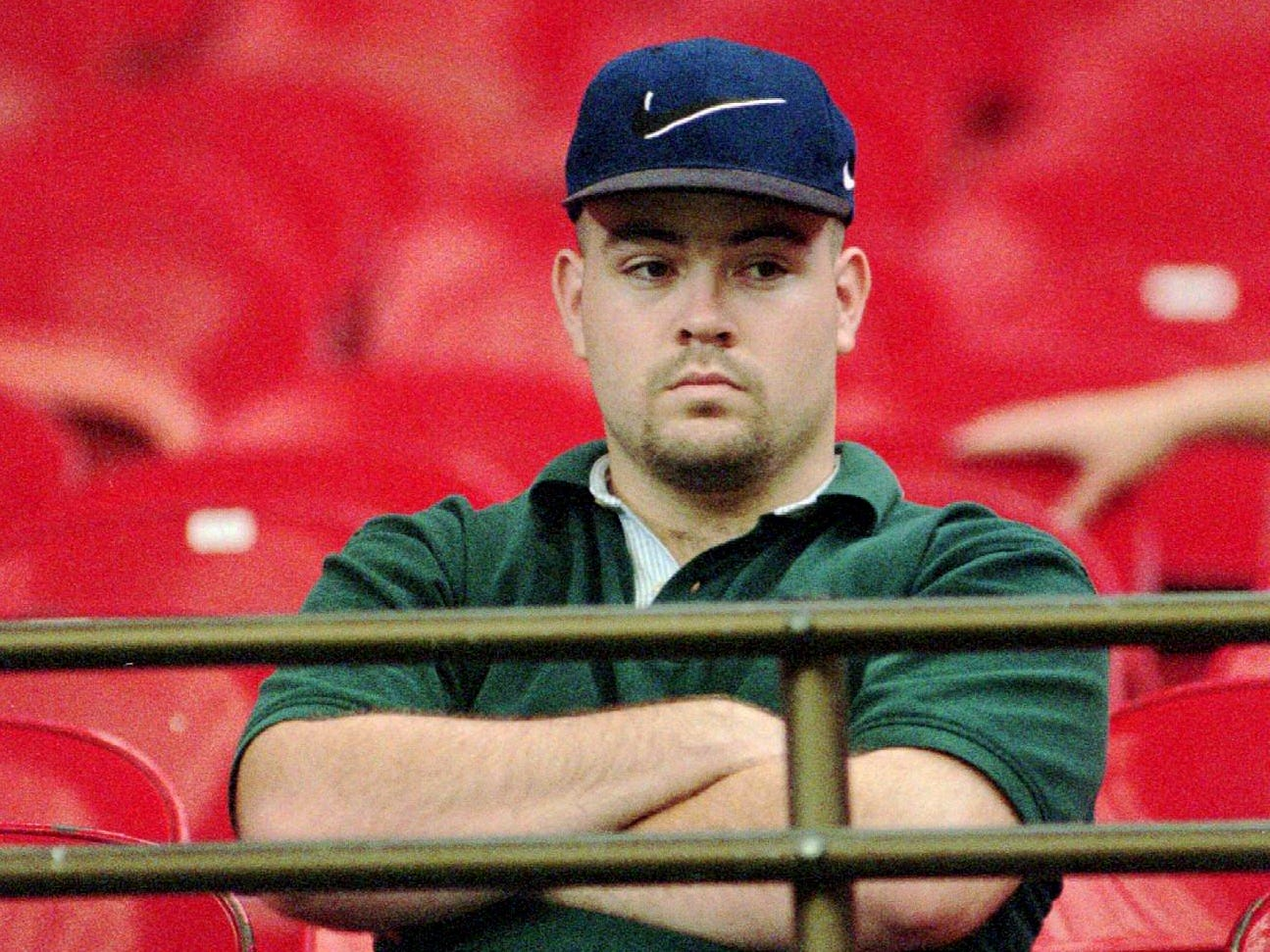 Houston Oilers fan Chris Harris sits alone on the front row in the end zone during the first quarter of the Oilers' Sept. 1, 1996 20-19 loss to the Kansas City Chiefs in Houston. The Oilers are looking at a lonely final season in the Bayou City before they move to Nashville in 1997.